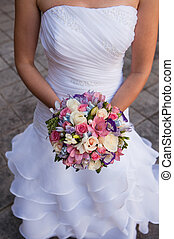 Beautiful wedding a bouquet in hands of the bride - round...