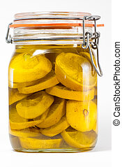 Preserved lemons - Jar of preserved lemons on a white...