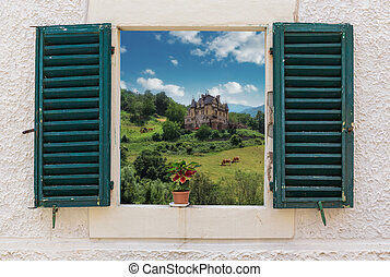 View of the rural landscape through the open window with...