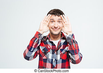 Funny man looking at camera isolated on a white background