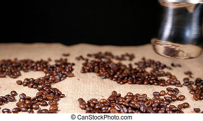 Coffe in Cezve and Coffee Beans on Bagging 3 - Coffe in...
