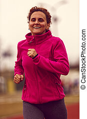 Healthy lifestyle - woman running, jumping