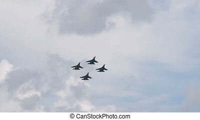 Four fighter planes together in sky - Four fighter airplanes...