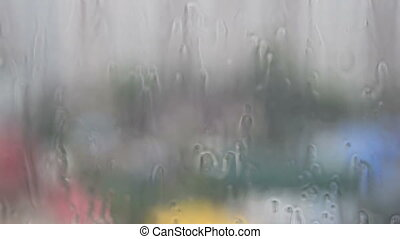 Pouring rain, view through the window
