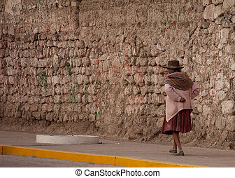 Old Woman walking on street in Peru