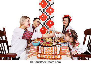 family at the festive Easter table - Slavic family at the...