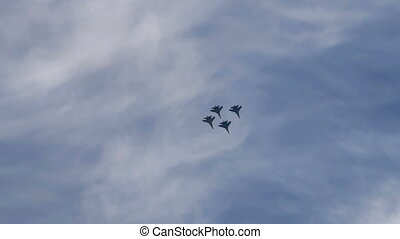Fighter aircraft performing in the sky - Four fighter planes...