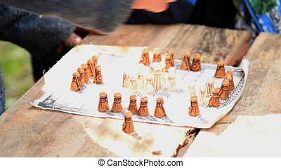 Ancient board game - Man playing and explaining ancient...