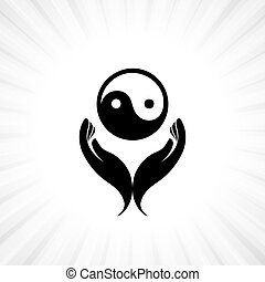 Person praying with yin yang symbol in hand - concept of a...