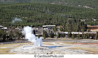 Old Faithful Eruption with a high angle point of view in...