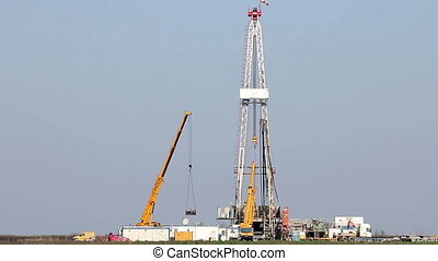 land oil drilling rig and cranes