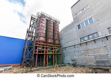Concrete mixing tower of the factory producing blocks