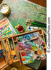 Workplace of the artist with brushes and oil paints -...