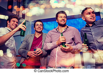 group of male friends with beer in nightclub - nightlife,...