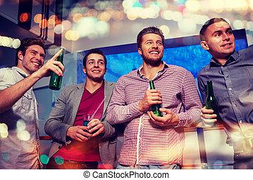group of male friends with beer in nightclub - nightlife,...
