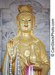 Chinese deity statue - Image of a chinese female deity...