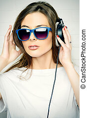 casual girl in headphones - Modern young woman enjoys the...