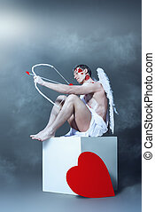 Cupids arrows - Male angel Cupid with a bow and arrows of...