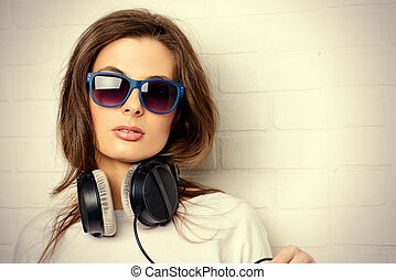 entertainment - Modern young woman enjoys the music on...