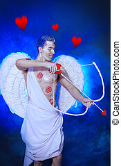 heavenly resident - Male angel Cupid with a bow and arrows...