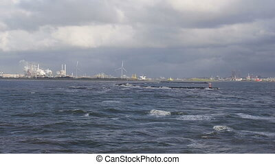 North Sea coast at IJmuiden filmed from a cruise ship...