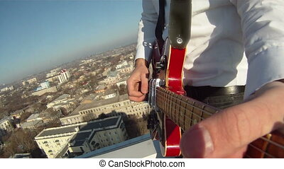 Hands of men play the guitar - A man plays the guitar on the...