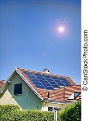 solar panels - solar panel on blue sky and sun shiny