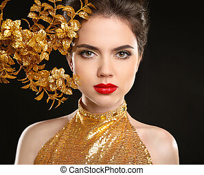Beauty fashion woman in golden dress Red lips Glamour...