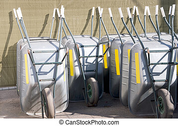 wheel barrows - many pushcarts in a row