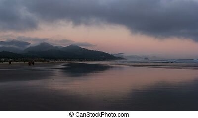 Time lapse in Cannon Beach lowtide - Time lapse of moving...