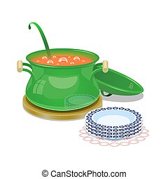 Iron pan with hot soup and some plates