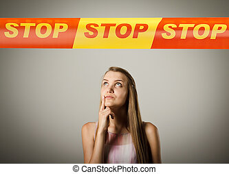 Girl and STOP line. - Woman and STOP line over her head....