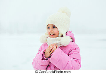 Portrait of cute little girl child looking away in winter...
