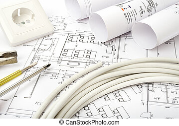 Architecture plan and rolls of blueprints with cable...