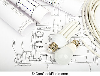 Architecture plan and rolls of blueprints with bulbs...