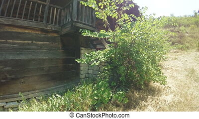 Antique wooden house - Steadicam camera on by old wooden...
