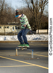 Young skateboarder performing a 50-50 grind