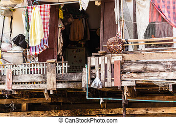 Slum - Wooden slums on stilts on the riverside of Chao Praya...