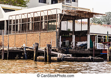 Dilapidated pier - a dilapidated old pier on the chao praya...
