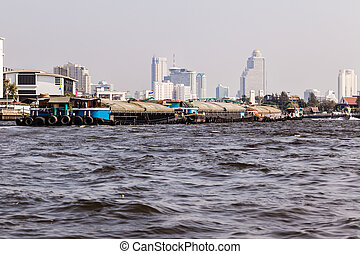 Barge convoy - a very big barge floating on Chao Praya River...