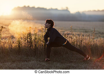 Young female exercising in the morning