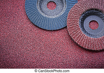 Flap grinding wheels on sandpaper directly above