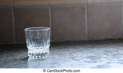 Pouring Beverage - Brown soda gets pored into a short glass...