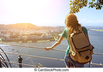 girl at the Rio de Janeiro - girl tourist with a backpack on...