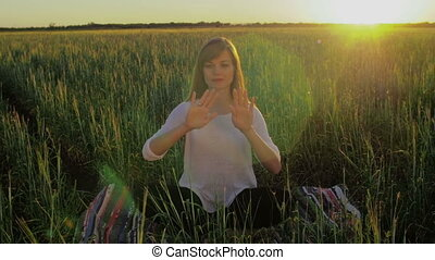 Woman in field make gestures for motion graphics - A woman...