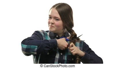 Young woman cutting hair on white background