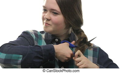 Young woman cutting hair, close up on white background