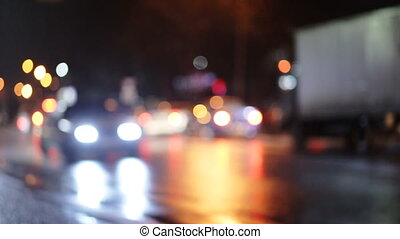 Diffused background with blurring lights of cars on the road...