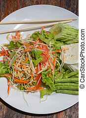 Thai papaya salad also known as Som Tam from Thailand. -...