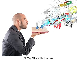 Business knowledge - Businessman blowing over a magic...